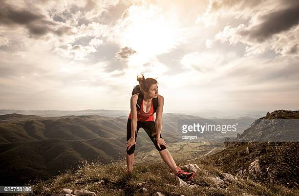 Athlete Cooling Down on the Top of The Hill