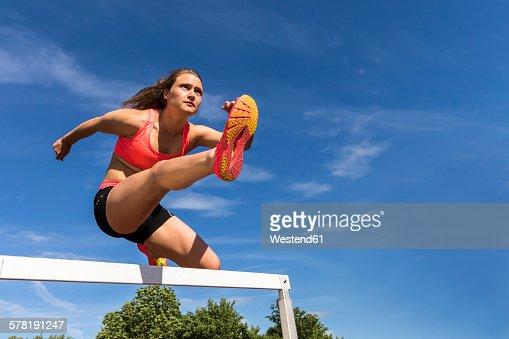 Athlete crossing a hurdle