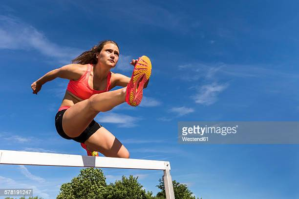 Athlete crossing a hurdle
