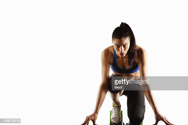 Athlete crouched at starting block