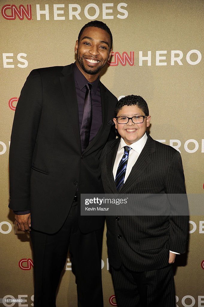 Athlete <a gi-track='captionPersonalityLinkClicked' href=/galleries/search?phrase=Cullen+Jones&family=editorial&specificpeople=1047215 ng-click='$event.stopPropagation()'>Cullen Jones</a> (L) and actor Rico Rodriguez attend the CNN Heroes: An All Star Tribute at The Shrine Auditorium on December 2, 2012 in Los Angeles, California. 23046_005_KM_0259.JPG