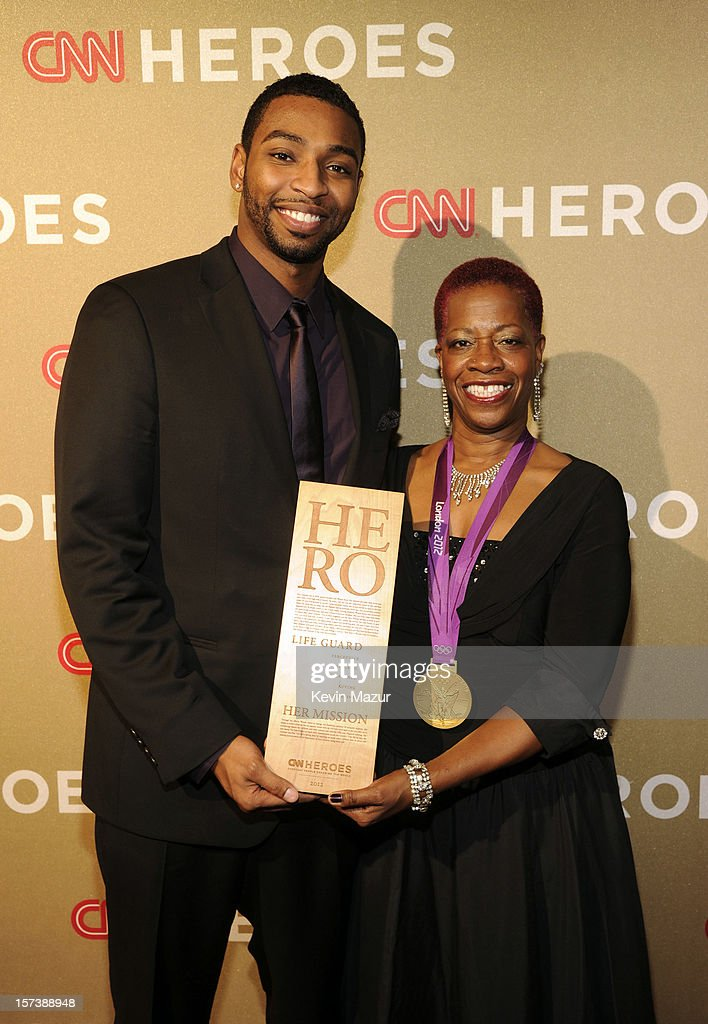 Athlete <a gi-track='captionPersonalityLinkClicked' href=/galleries/search?phrase=Cullen+Jones&family=editorial&specificpeople=1047215 ng-click='$event.stopPropagation()'>Cullen Jones</a> (L) and honoree Wanda Butts of The Josh Project attend the CNN Heroes: An All Star Tribute at The Shrine Auditorium on December 2, 2012 in Los Angeles, California. 23046_005_KM_0241.JPG