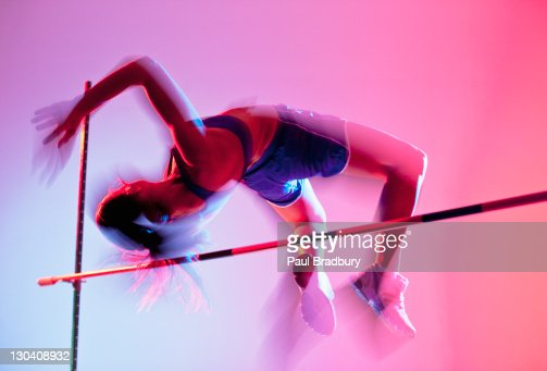 Athlete curling over high jump : Stock Photo