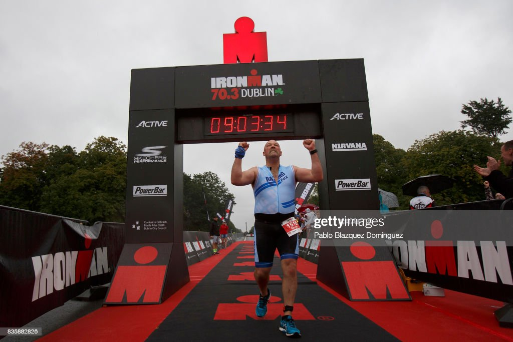 Athlete Darren Linton celebrates after he was the last competitor crossing the finish line of IRONMAN 70.3 Dublin on August 20, 2017 in Dublin, Ireland.