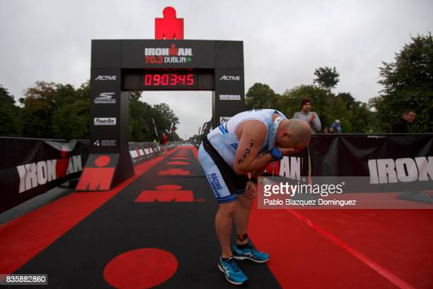 Athlete Darren Linton takes a breath after he was the last competitor crossing the finish line of IRONMAN 703 Dublin on August 20 2017 in Dublin...