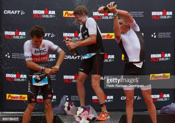Athlete David McNamee from Great Britain celebrates winning the men race of IRONMAN 703 Dublin with Romain Guillaume from France second and Sean...