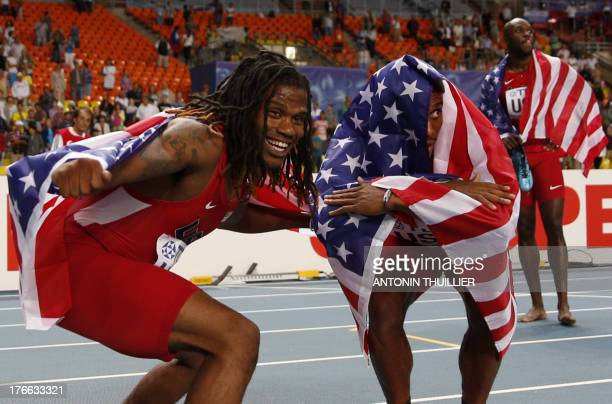 US athlete David Verburg poses with US athlete Arman Hall after winning the men's 4x400 metres relay final at the 2013 IAAF World Championships at...