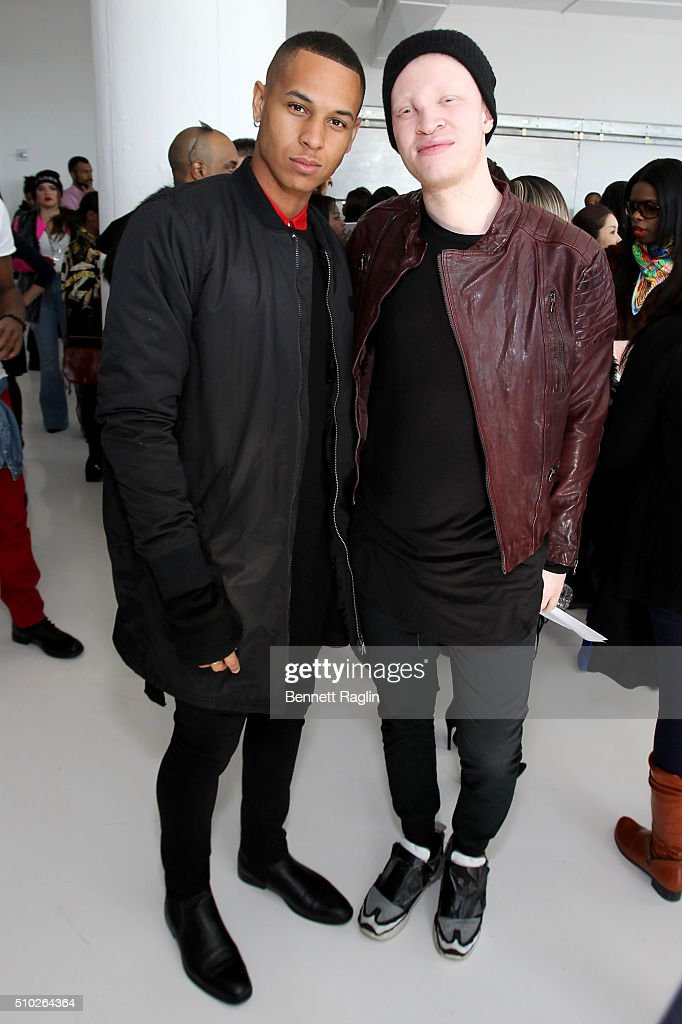 Athlete Devin Harrison (L) and model Shaun Ross pose during SheaMoisture at Laquan Smith F/W 2016 NYFW at Jack Studios on February 14, 2016 in New York City.