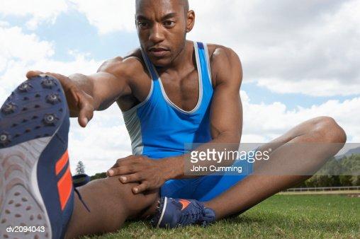 Athlete Doing Stretches : Stock Photo