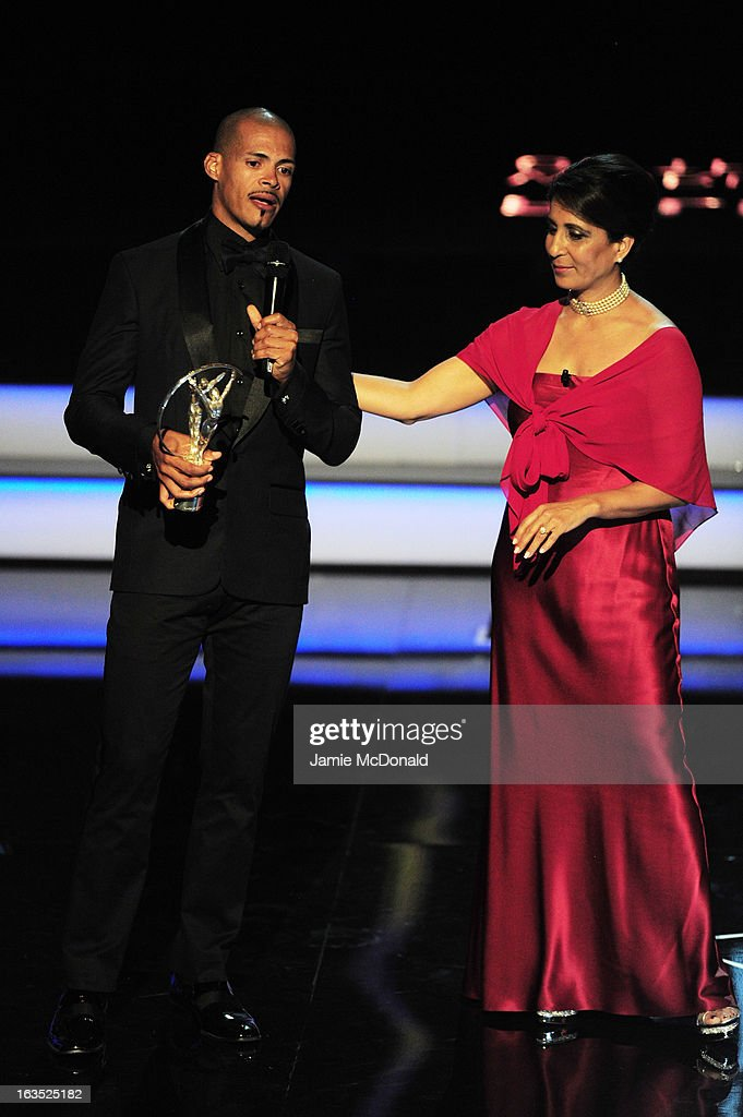 Athlete Felix Sanchez accepts his award for 'Laureus World Comebcak of the Year' from Laureus Academy Member <a gi-track='captionPersonalityLinkClicked' href=/galleries/search?phrase=Nawal+El+Moutawakel&family=editorial&specificpeople=215203 ng-click='$event.stopPropagation()'>Nawal El Moutawakel</a> during the awards show for the 2013 Laureus World Sports Awards at the Theatro Municipal Do Rio de Janeiro on March 11, 2013 in Rio de Janeiro, Brazil.