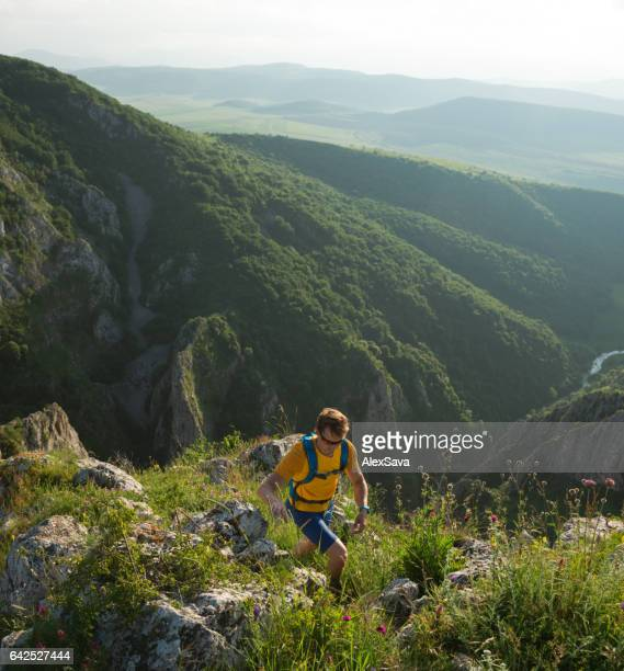 Athlete hiking through nature on a summer day