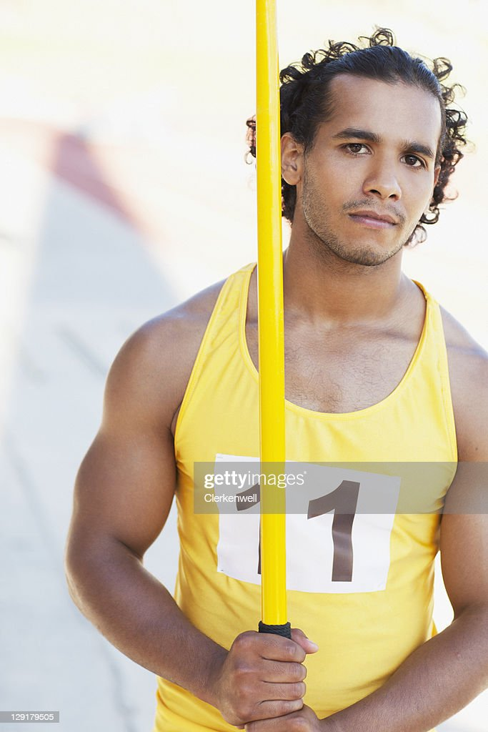 Athlete holding a javelin : Stock Photo