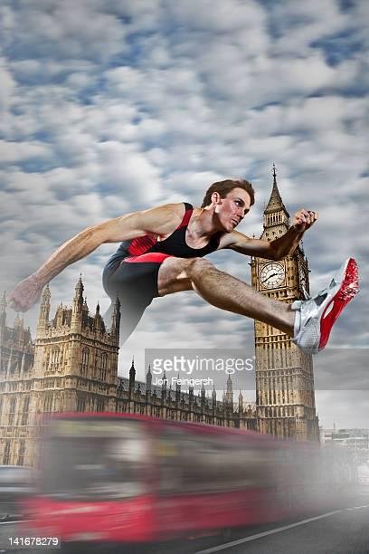 Athlete Hurdling over Monument