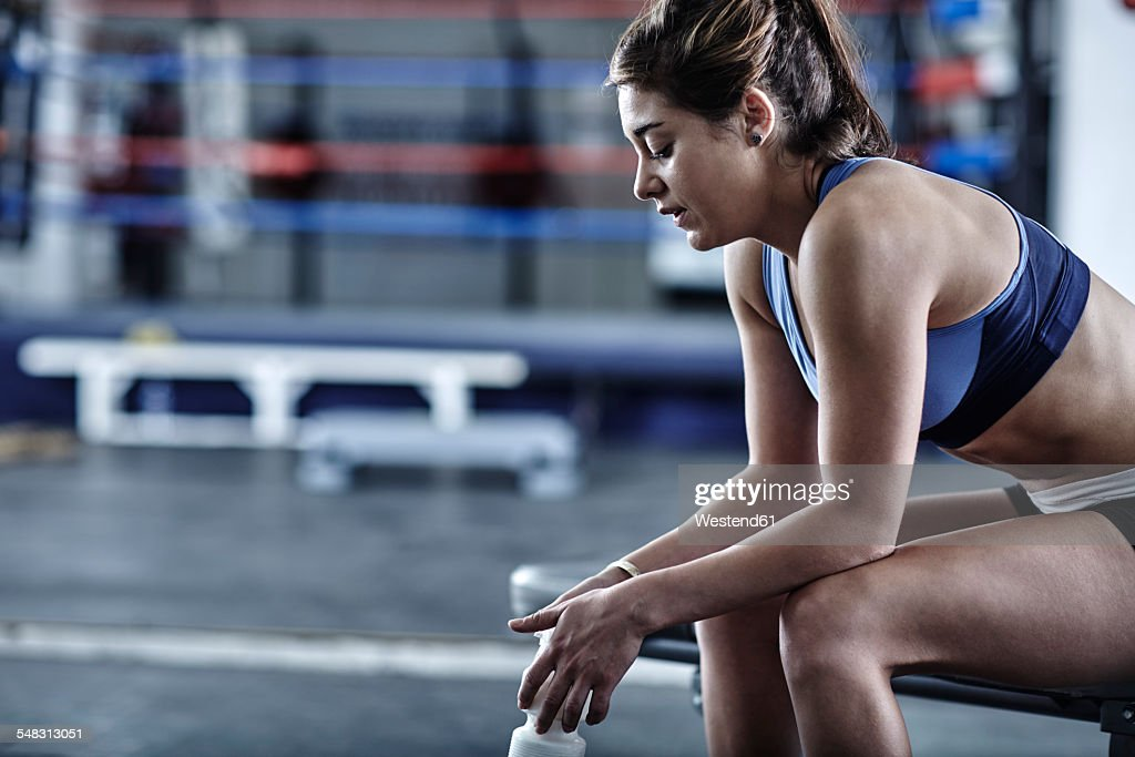 Athlete in gym having a break