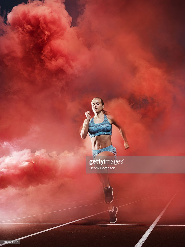 athlete in red smoke