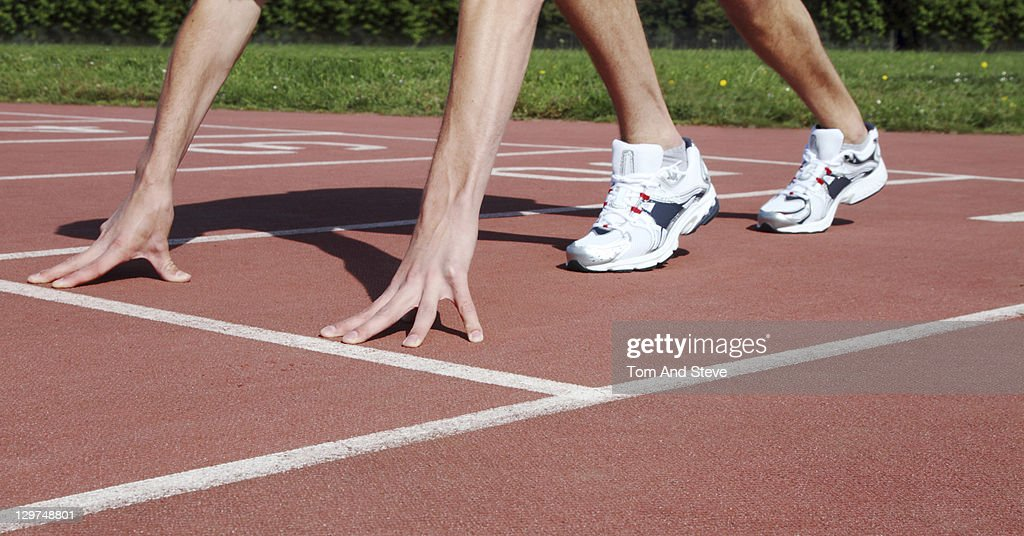 Athlete in starting permission on track : Stock Photo