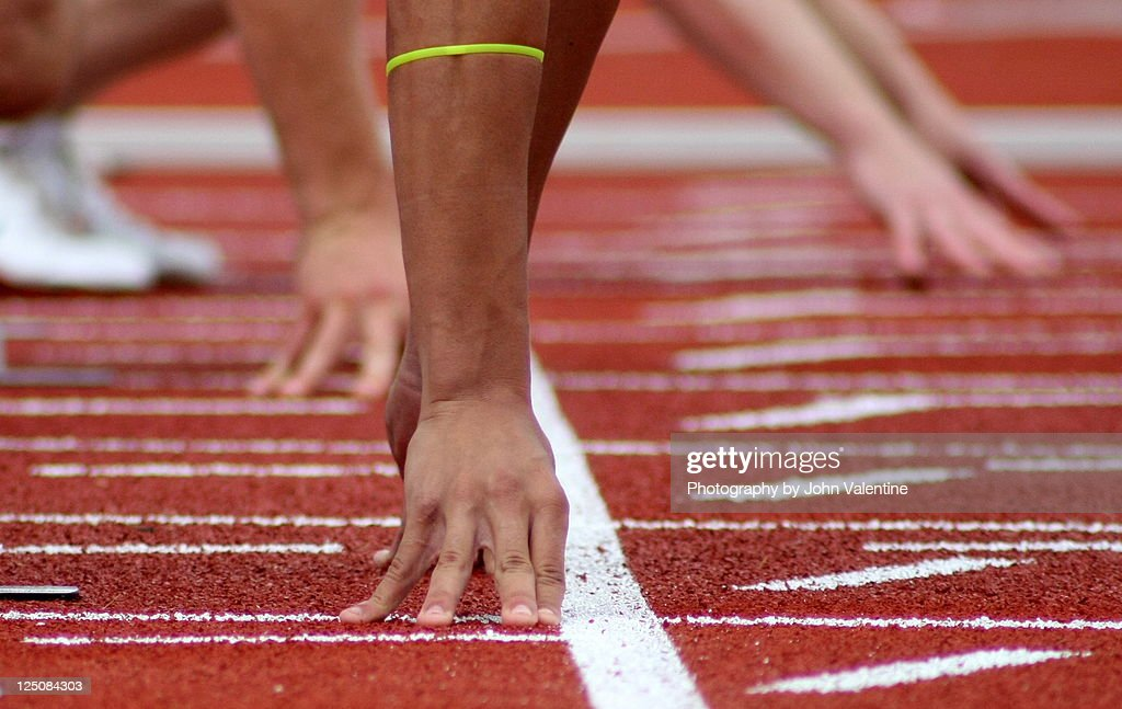 Athlete in starting position on track : Stock Photo