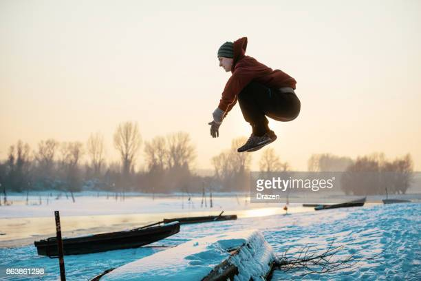 Athlete is showing off his courage and strength on outdoor training in winter