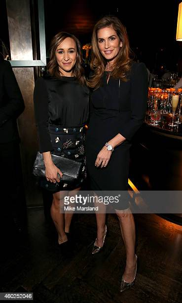 Athlete Jessica EnnisHill and model Cindy Crawford attend the Omega Oxford Street Store Opening Party at The Shard on December 10 2014 in London...