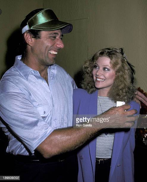 Athlete Joe Namath and actress Audrey Landers pose for photographs backstage after performance of 'Damn Yankees' on July 15 1981 at the Jones Beach...