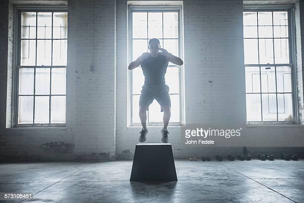 Athlete jumping on platform
