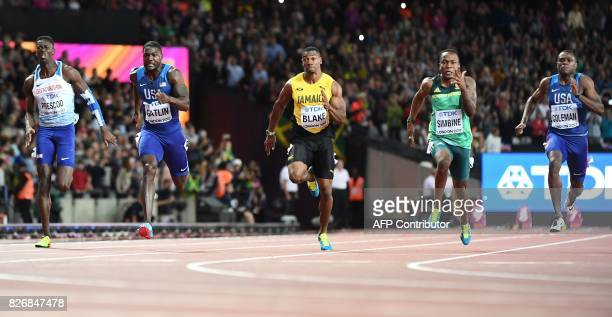 US athlete Justin Gatlin heads toward the finish line to win the final of the men's 100m athletics event ahead of Britain's Reece Prescod Jamaica's...