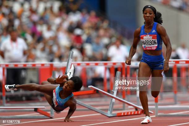 TOPSHOT US athlete Kendra Harrison runs to the line to win the women's 100m hurdles final as US athlete Jasmin Stowers falls after hitting the final...