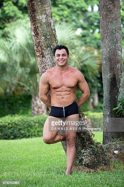 Athlete leaning against palm tree