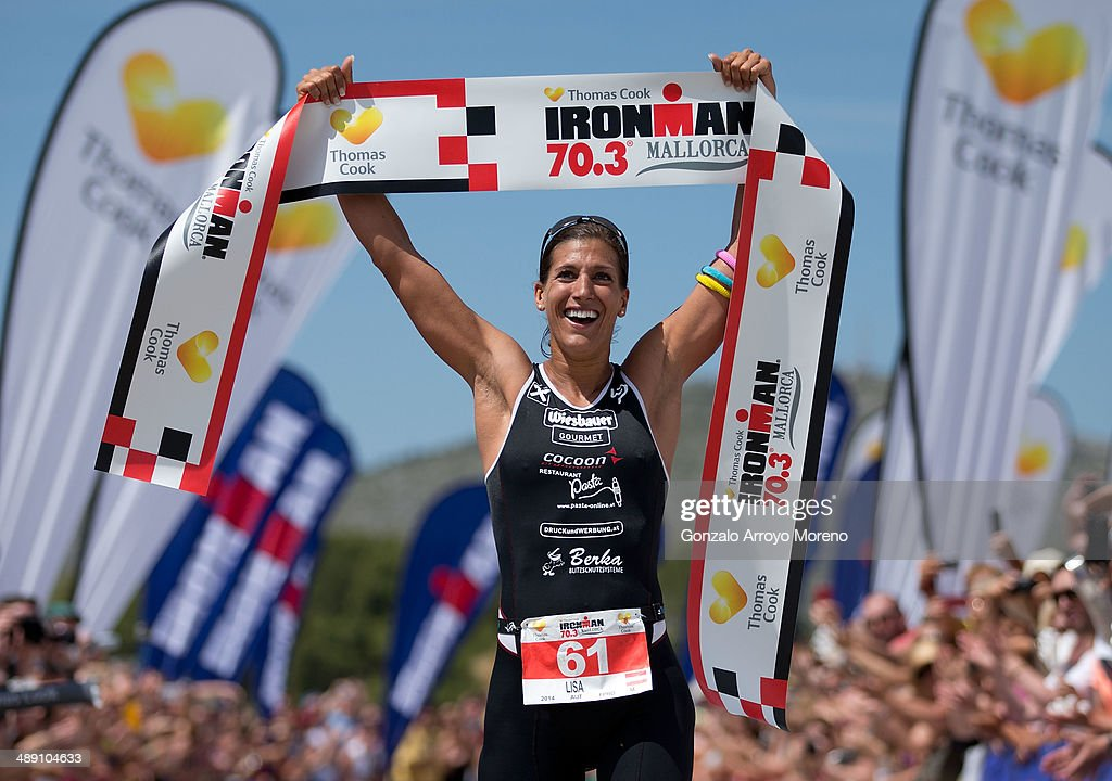 Athlete Lisa Huetthaler is the first woman to cross the finish line during the Ironman 70.3 Mallorca on May 10, 2014 in Mallorca, Spain.