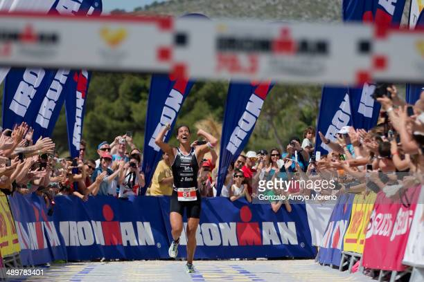 Athlete Lisa Huetthaler is the first woman to cross the finish line during the Ironman 703 Mallorca on May 10 2014 in Mallorca Spain