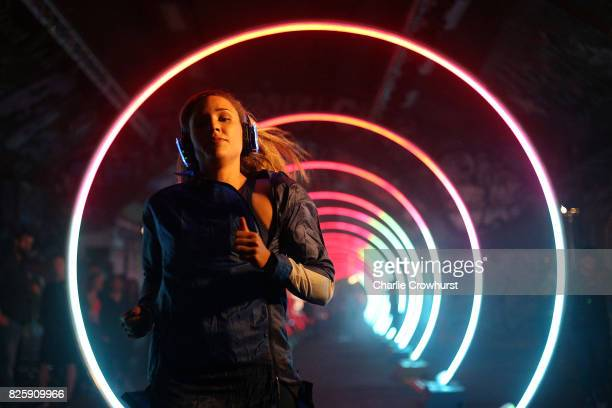 USA athlete Lolo Jones attends the launch of ASICS Run The Tube experience an epic 85metre LED tunnel made from hoops of light Run The Tube is part...