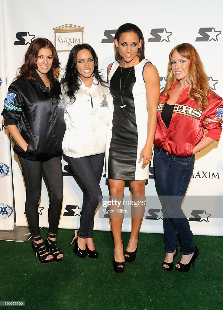 Athlete <a gi-track='captionPersonalityLinkClicked' href=/galleries/search?phrase=LoLo+Jones&family=editorial&specificpeople=604165 ng-click='$event.stopPropagation()'>LoLo Jones</a> (C) poses on the Starter Red Carpet at the Maxim Party during Super Bowl XLVII at Second Line Warehouse on February 2, 2013 in New Orleans, Louisiana.