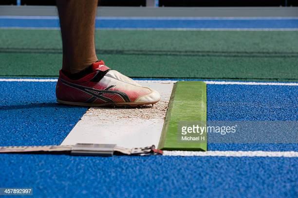 athlete long jumping,close up