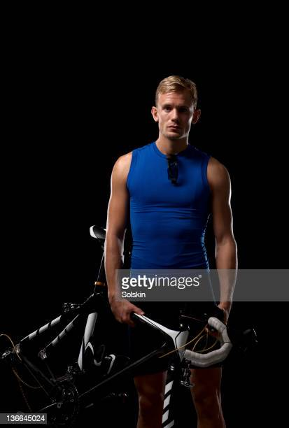 athlete man holding cycle over shoulder