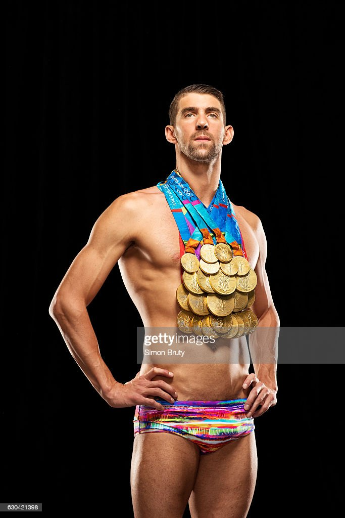 Athlete Michael Phelps poses with his Olympic medals, 28 in all, 23 gold, for Sports Illustrated on August 29, 2016, in New York City. PUBLISHED COVER.