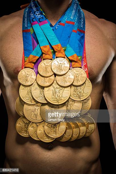 Athlete Michael Phelps poses with his Olympic medals 28 in all 23 gold for Sports Illustrated on August 29 in New York City CREDIT MUST READ Simon...
