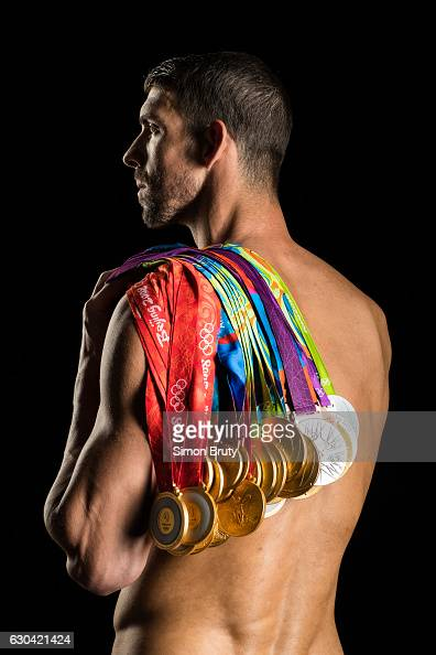 Athlete Michael Phelps poses with his Olympic medals 28 in all 23 gold for Sports Illustrated on August 29 in New York City PUBLISHED IMAGE CREDIT...