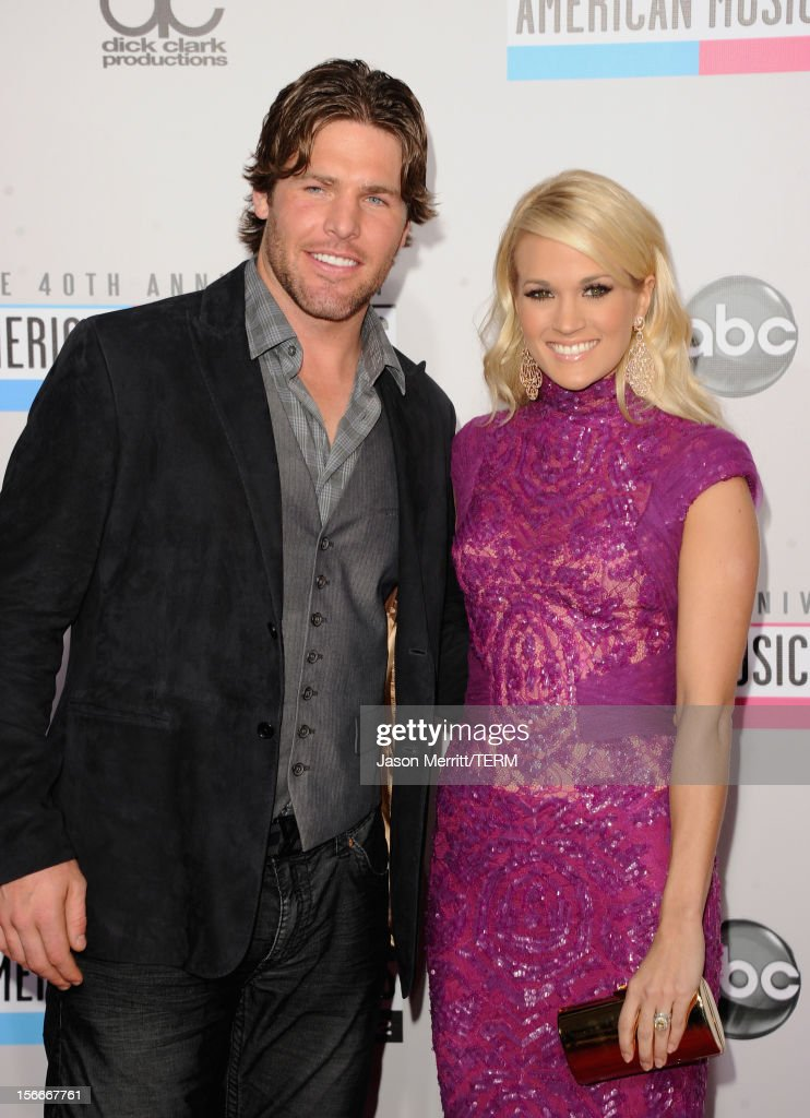 Athlete Mike Fisher and singer Carrie Underwood attend the 40th American Music Awards held at Nokia Theatre L.A. Live on November 18, 2012 in Los Angeles, California.