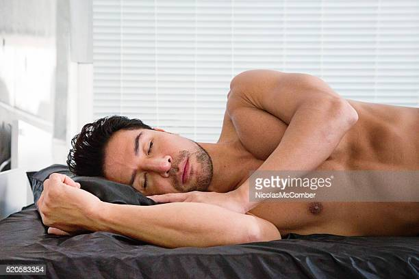 Athlete napping on his side