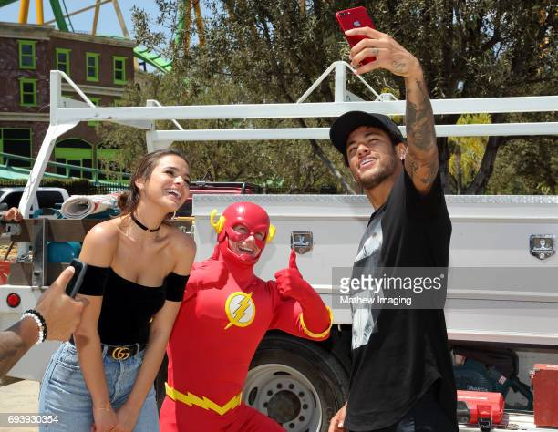 Athlete Neymar Jr and actor Bruna Marquezine ran into FLASH at the construction site of the new JUSTICE LEAGUE Battle For Metropolis ride at Six...