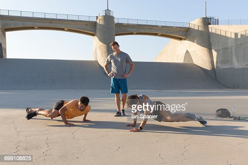 'Athlete observing friends workout, Van Nuys, California, USA'
