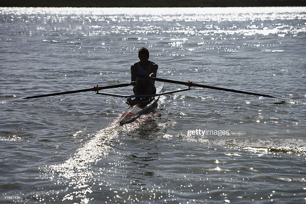Athlete on a small row boat : Stock Photo