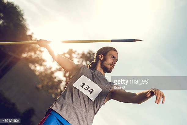 Athlete on competition ready to throw a javelin.