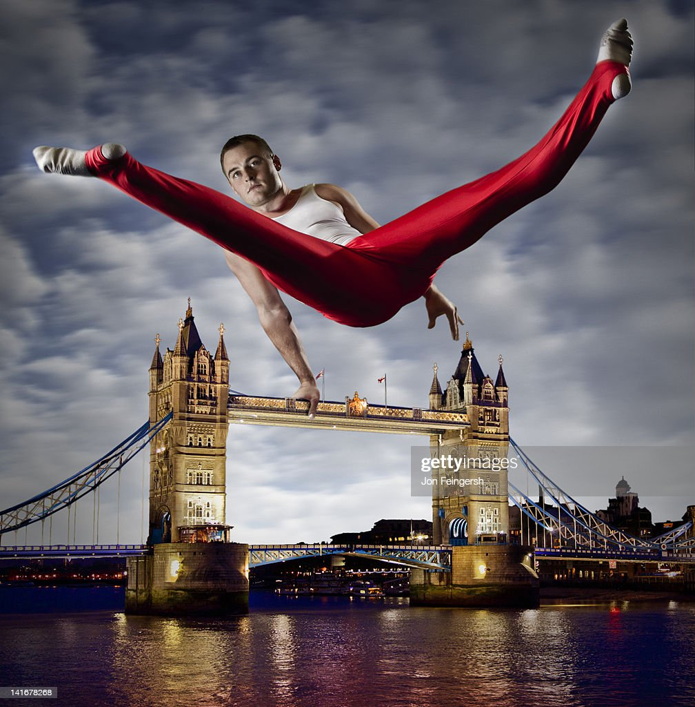 Athlete Performs on Monument : Stock Photo