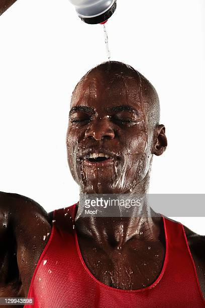 Athlete pouring water over his head