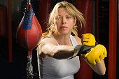 Athlete Practicing on Punching Bag