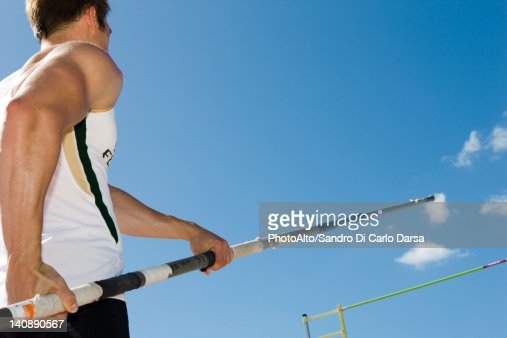 Athlete preparing for pole vault, low angle view
