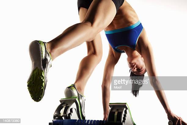 Athlete putting feet into starting block