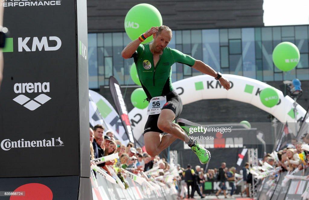 A athlete reacts after finishing the KMD IRONMAN Copenhagen on August 20, 2017 in Copenhagen, Denmark.