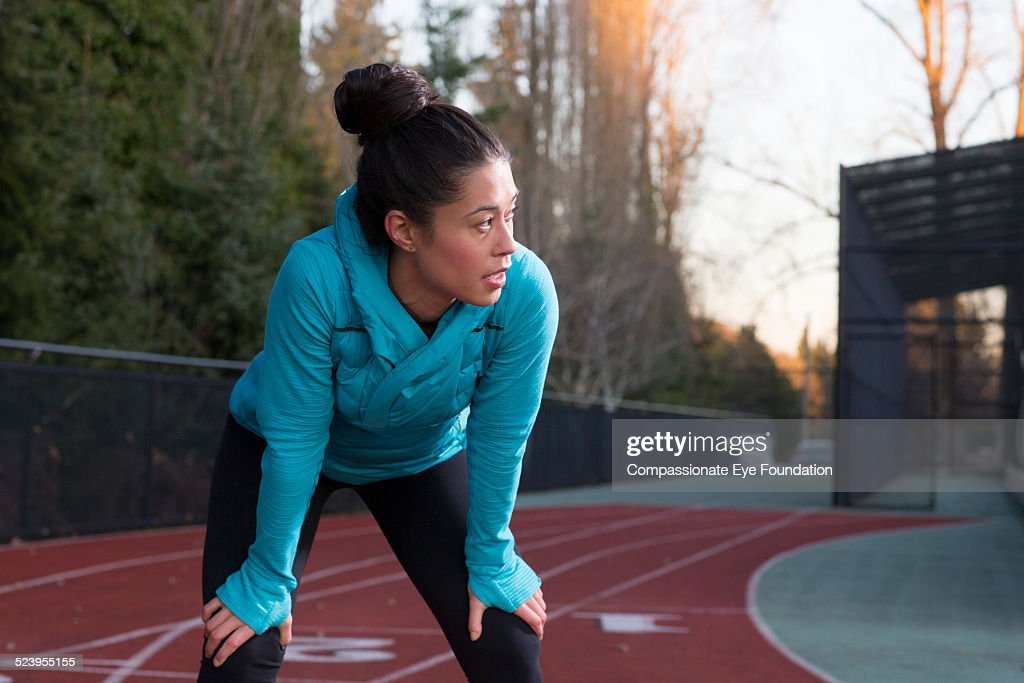 Athlete resting on track